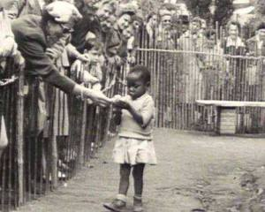 Congolese girl being fed at an enclosure of one of the last Human Zoos in Europe. Brussels, 1958.